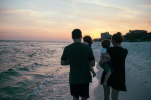 family with kids enjoying the sunset at one of the best beaches near charleston sc