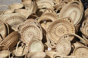 shopping in the historic charleston city market is free, and a great place to buy locally-made sweetgrass baskets