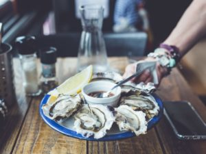 raw oysters being served at one of the best seafood restaurants in downtown charleston sc