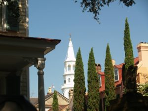 a view of st michael's church from the south of broad neighborhood in historic downtown charleston sc